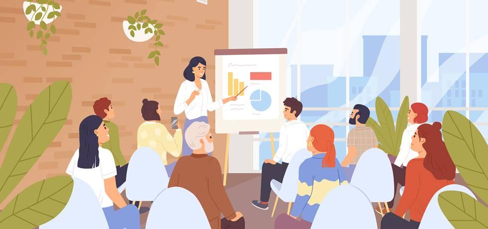 mentora e um grupo de mentorados sentados acompanhando uma apresentação